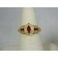 R717 ~ 14k Marquise Ruby & Diamond Ring