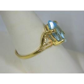 R162 ~ 10k Blue Topaz Ring